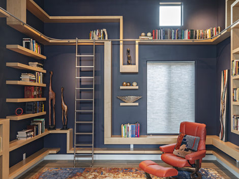contemporary wood library with floating shelves and stainless steel rolling ladder by paul rene furniture and cabinetry phoenix az