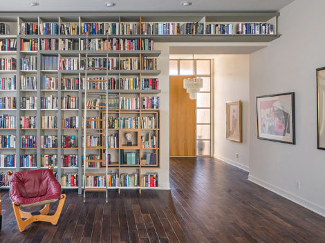 custom designed modern library with stainless steel rolling ladder by paul rene phoenix az