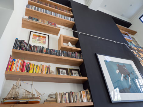 custom-reclaimed-white-oak-floating-bookshelves-with-staineless-steel-ladder-by-paul-rene-furntiure-and-cabinetry-phoenix-az.jpg