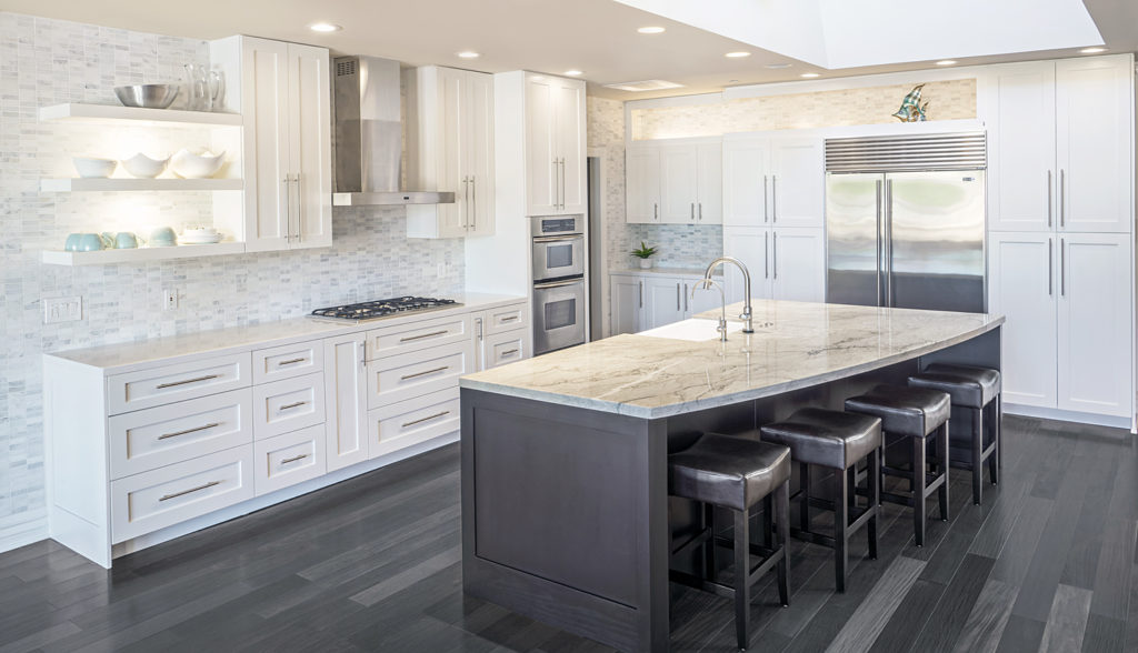 custom designed kitchen cabinets white shaker with mocha island with curved island and sub zero wolf appliances