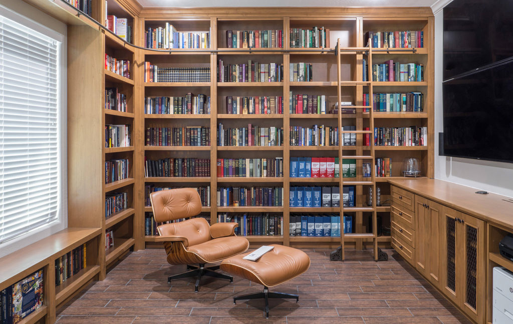 custom built in libraries-with-rolling-ladders by paul rene furniture and cabinetry phoenix az